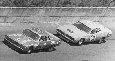 Donnie Allison's Chevrolet leads Richard Petty's Dodge in the closing stages of the 1974 Daytona 500.