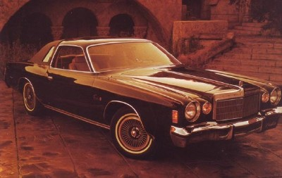 The 1975 Cordoba's sculptured pods above the headlights and large parking lights add a touch of distinction.