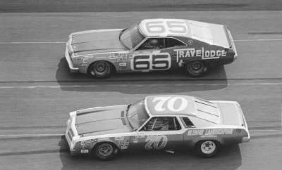J.D. McDuffie's #70 Chevrolet runs beside rookie Carl Adams in the July 4 Daytona Firecracker 400.