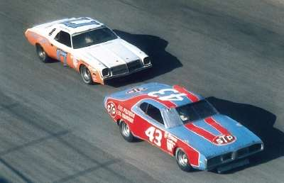 Darrell Waltrip's #17 Chevy chases Richard Petty's Dodge in a 1975 NASCAR Winston Cup Grand National event.