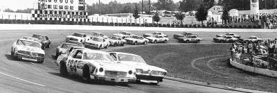 Darrell Waltrip (#88) and Neil Bonnett on the opening lap of the April 24, 1977 Virginia 500.