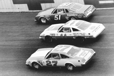 Cruising in the 1978 Daytona 500 are #27 Buddy Baker, #11 Cale Yarborough, and #51 A.J. Foyt.