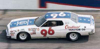 Dale Earnhardt rides the high line in Will Cronkrite's #96 Cardinal Tractor Ford in Daytona's 1978 Firecracker 400.