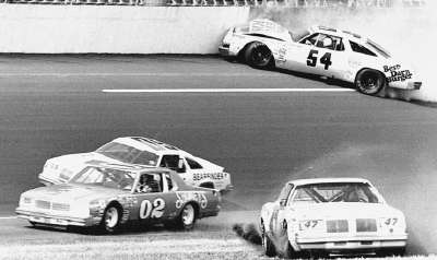 Lennie Pond crashes his #54 Oldsmobile into the wall during the Twin 125-mile qualifier at Daytona on Feb. 15, 1979.