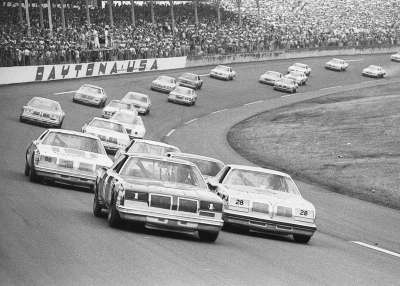 Donnie Allison pushes his #1 Oldsmobile ahead of pole-sitter #28 Buddy Baker at the 1979 Daytona 500.