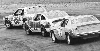 Darrell Waltrip (#88) leads #11 Cale Yarborough and #43 Richard Petty during the April 22, 1979 Virginia 500.