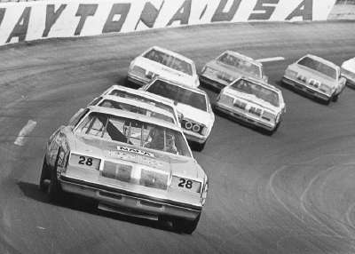 Buddy Baker leads a pack of cars off the fourth turn in the Feb. 17, 1980 Daytona 500.