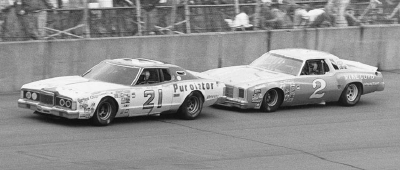 Neil Bonnett and Dale Earnhardt run in close formation in the June 15, 1980 400-miler at Michigan International Speedway.