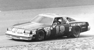 Donnie Allison guides his #12 Oldsmobile back to the pits after engine failure in the Aug. 3, 1980 Talladega 500.