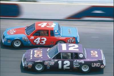 Tim Richmond, in Kennie Childers' #12 Buick, races Richard Petty during the July 4, 1981 Daytona Firecracker 400.