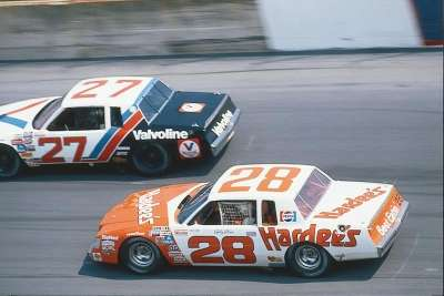 Bobby Allison (#28) pairs up with #27 Cale Yarborough in a battle for the lead in the 1981 Firecracker 400.