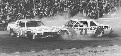 Joe Millikan loses the grip on his #50 Pontiac in front of #71 Dave Marcis during the 1982 Richmond 400.