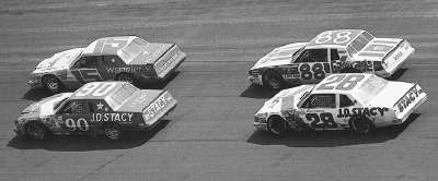 Jody Ridley (#90) and #28 Benny Parsons battled #15 Dale Earnhardt and #88 Bobby Allison in the 1982 Winston 500.