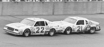 Number 22 Bobby Allison and #21 Buddy Baker hook up in a tight draft during the June 19 Gabriel 400.