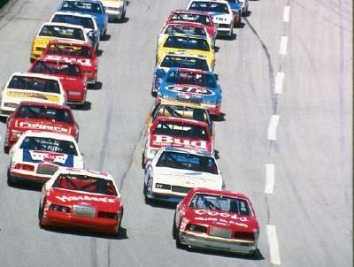 Front-row starters Bill Elliott and Cale Yarborough lead the field at the start of the 1985 Winston 500.