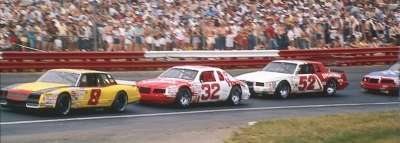 Bobby Hillin, Jr. (#8) feels pressure from #32 Alan Kulwicki and #53 Jimmy Means in the 1985 Wrangler Sanfor-Set 400.