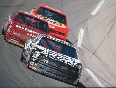 Phil Parsons runs inches ahead of Ken Schrader and Darrell Waltrip in the 1988 Winston 500 at Talladega.