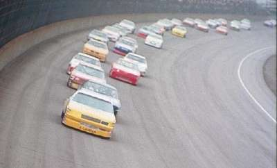 Drivers race the rounded front chute at Michigan International Speedway during the Aug. 20 Champion Spark Plug 400.