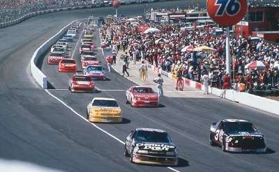Dale Earnhardt and Rusty Wallace lead the field off pit road during the 1990 Motorcraft Quality Parts 500.