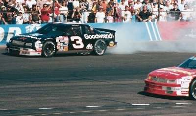 Dale Earnhardt spews smoke at the 1991 Pyroil 500, a NASCAR Winston Cup series event.