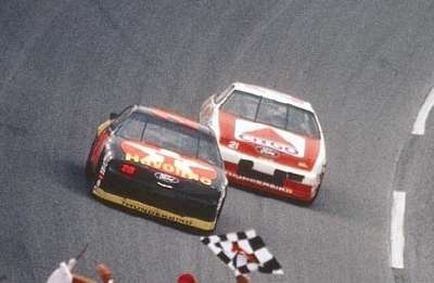 Davey Allison barely beats Morgan Shepherd to win the 1992 Daytona 500, part of the NASCAR Winston Cup series.
