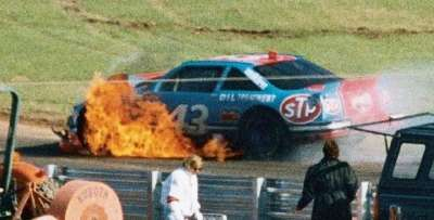Driver Richard Petty's car is engulfed in flames during the 1992 Hooters 500, a NASCAR Winston Cup Series event.