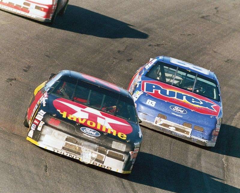 Davey Allison and Lake Speed drive in the 1992 Mello Yello 500, a NASCAR Winston Cup series event.