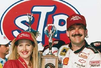 Dale Jarrett holds the winner's trophy for the 1993 Daytona 500, a NASCAR Winston Cup series event.