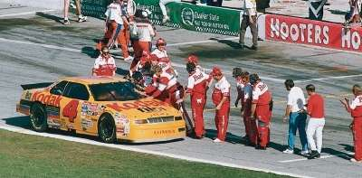 Pit crews gather to congratulate driver Sterling Marlin on his 1994 Daytona 500 win -- a NASCAR Winston Cup event.