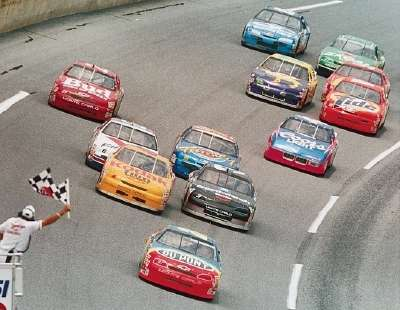 Jeff Gordon leads the pack toward the finish in the 1995 Pepsi 400, a NASCAR Winston Cup series event.