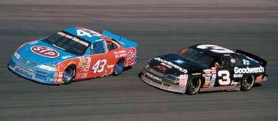 Bobby Hamilton and Dale Earnhardt drive in the 1996 Goodwrench 400, a NASCAR Winston Cup series event.