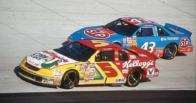 Terry Labonte and Bobby Hamilton drive in the 1996 Miller Genuine Draft 500, a NASCAR Winston Cup series event.