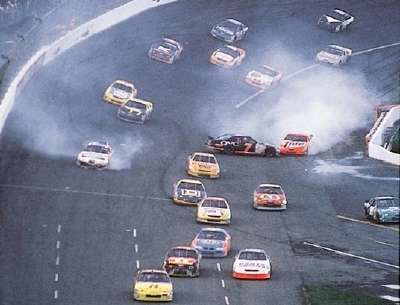An early accident complicates the course at the 1997 Coca-Cola 600, a NASCAR Winston Cup series event.