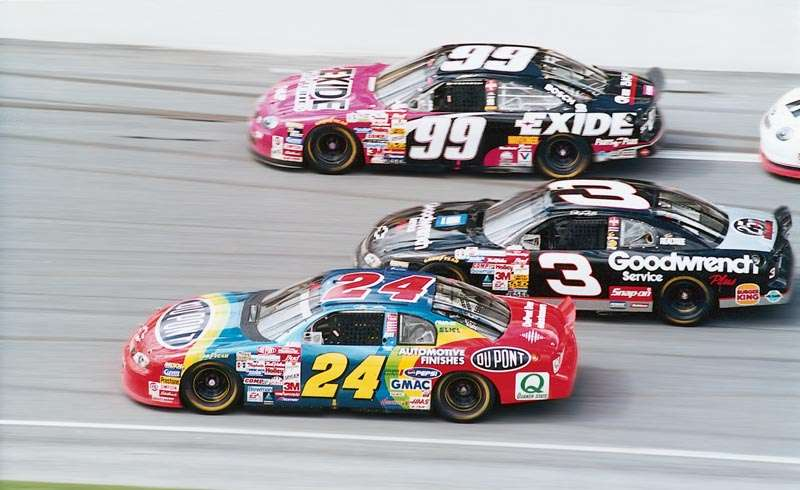 Jeff Gordon (#24), Dale Earnhardt (#3), and Jeff Burton (#99) race in NASCAR's 1999 Daytona 500.