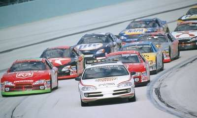 Bill Elliott and Casey Atwood lead the pace lap of the NASCAR 2001 Pennzoil Freedom 400.