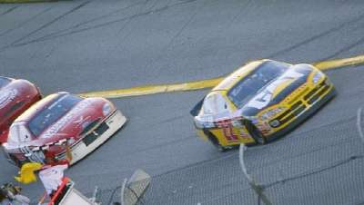 Ward Burton leads, and eventually wins, the 2002 Daytona 500, a NASCAR Winston Cup series event.