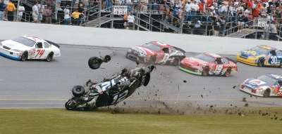 Ryan Newman's car flips during a crash in the 2003 Daytona 500, a NASCAR Winston Cup series event.