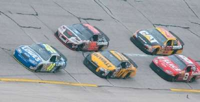 Jimmie Johnson leads Matt Kenseth and Dale Earnhardt, Jr. in the 2003 Aaron's 499, a NASCAR Winston Cup series event.