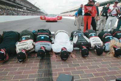 The winning team kisses the bricks at the 2003 Brickyard 400, a NASCAR Winston Cup series event.