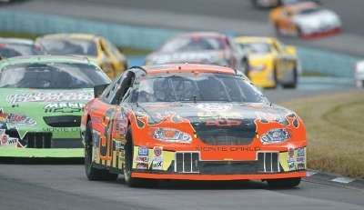 Robby Gordon drives in the 2003 Sirius @ The Glen event in the NASCAR Winston Cup series.