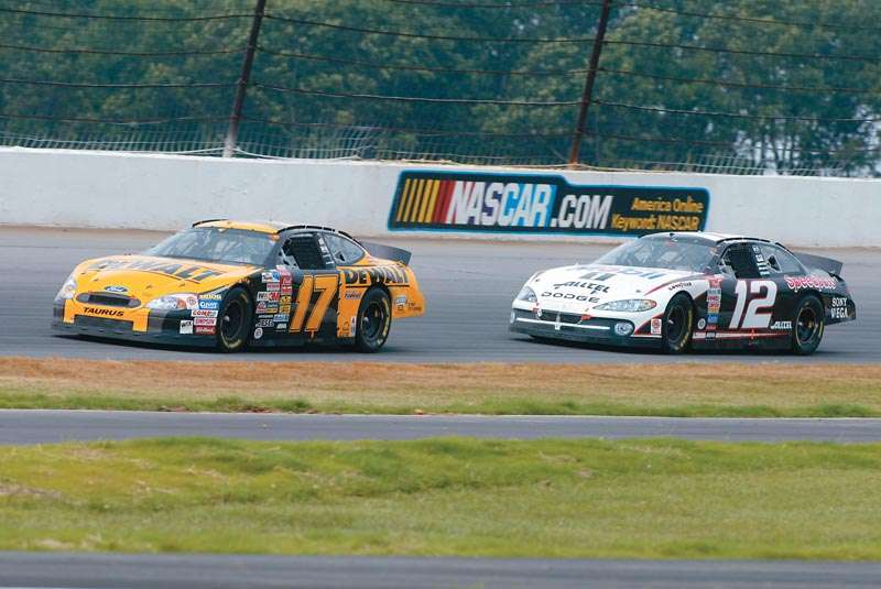 Matt Kenseth and Ryan Newman drive in the 2003 Pennsylvania 500, a NASCAR Winston Cup series event.