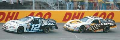 Ryan Newman passes DAle Jarrett in the 2004 DHL 400, a NASCAR NEXTEL Cup series event.