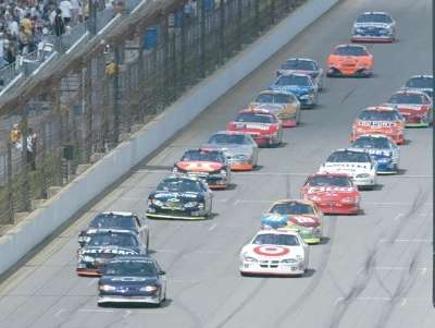 Casey Mears and Ward Burton lead the pack to start the 2004 Brickyard 400, a NASCAR NEXTEL Cup event.