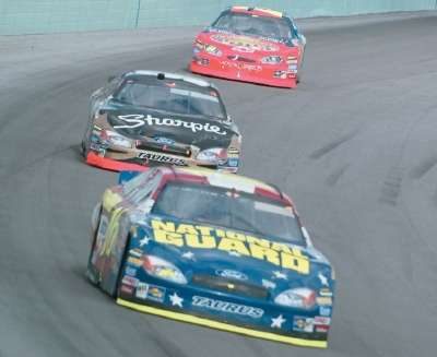 Greg Biffle leads Kurt Bush and Jeff Gordon in the 2004 Ford 400, a NASCAR NEXTEL Cup series event.