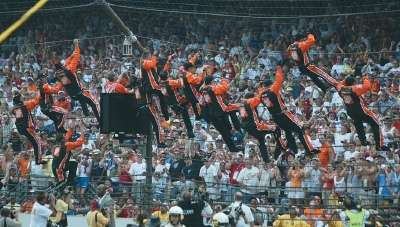Tony Stewart and his team scale the fence at Indianapolis Motor Speedway.