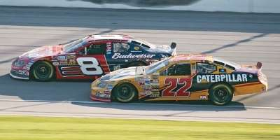 Dale Earnhardt, Jr. and Scott Wimmer drive in the 2005 USG Sheetrock 400, a NASCAR NEXTEL Cup series event.