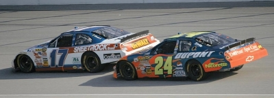 Jeff Gordon and Matt Kenseth drive in the 2006 USG Sheetrock 400, a NASCAR NEXTEL Cup series event.