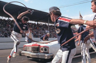 David Pearson's pit crew does its frenzied dance during the Virginia 500 at Martinsville Speedway on April 25, 1976.