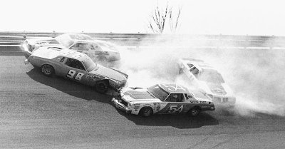 Roland Wlodyka spins his #98 Chevrolet, collecting #5 Neil Bonnett, #54 Lennie Pond, and #11 Cale Yarborough.