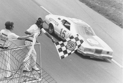 Bobby Allison powers his #15 Thunderbird under the checkered flag to win the July 4 Firecracker 400 at Daytona.